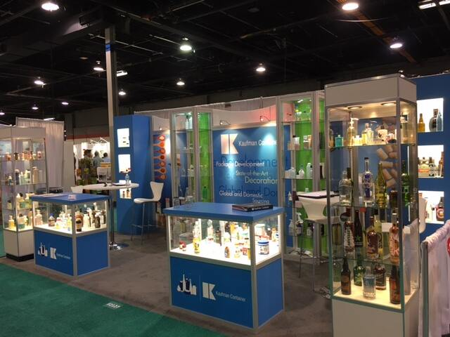 Kaufman Container company booth displaying custom packaging at an industry trade show