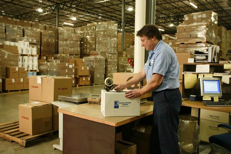 Kaufman Container employee handling the shipping of custom packaging in Cleveland, OH
